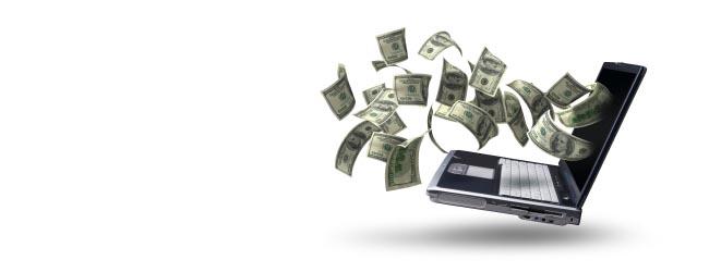 kantor internetowy pozwala na wymianę, zakup gotówki online, banknoty wylatują z laptopa